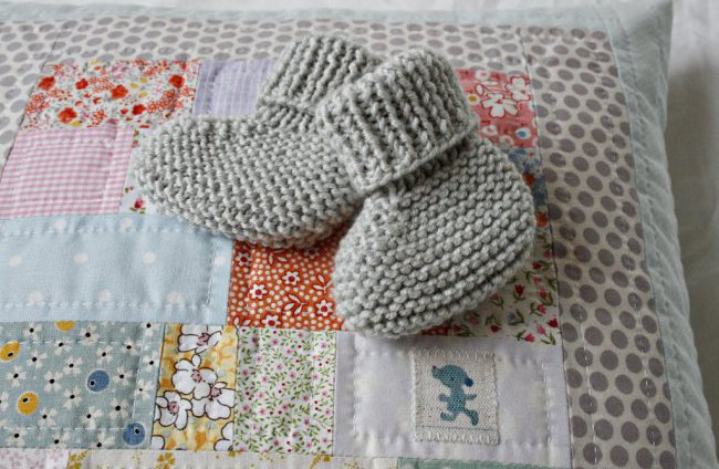 pillow with baby booties
